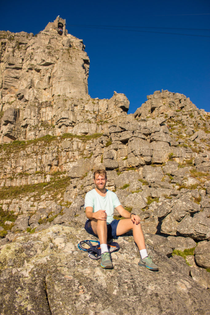 hiker relaxes below table mountain cableway