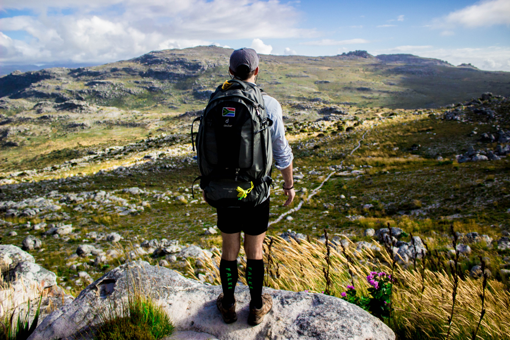 Hiker overlooks table mountain national park and silvermine nature reserve