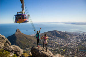 hikers wave to table mountain cable car